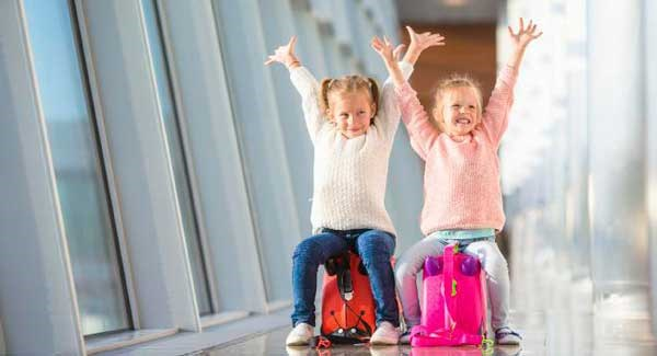 KidsInAirportOnSuitcase2016_large